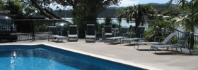 Heated swimming pool and sun deck at Acacia Lodge Motel Accommodation with views over the Mangonui Harbour